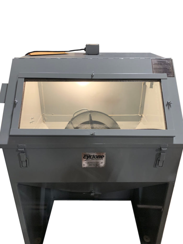 Cyclone T14 tumble blast cabinet - front light on